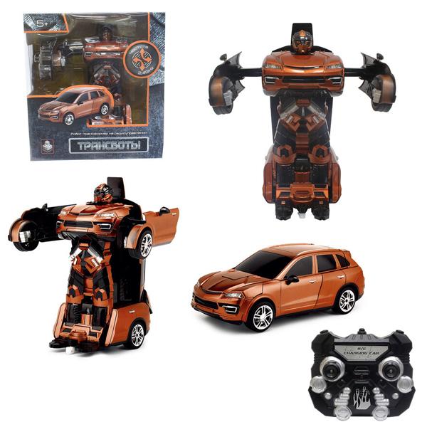 1toy T10859  Робот на р/у 2,4GHz, трансформирующийся в машину, 30 см, оранжевый
